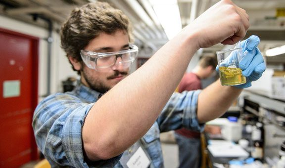 Engineering student works on an experiment in the Engineering Operations and Process Lab