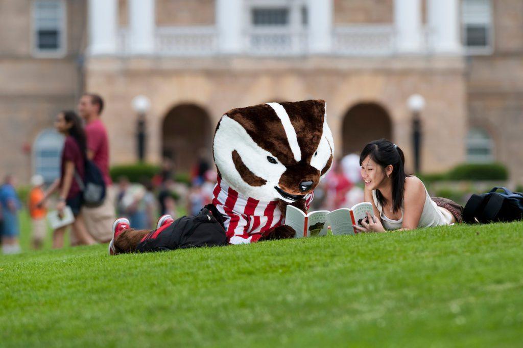 Bucky Badger reading