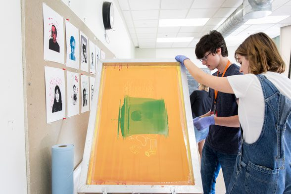 Imaging Self students practicing print making