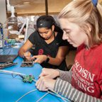 Two students working in Electric and Computer Engineering class