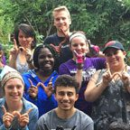 Study abroad students making W UW–Madison sigh with their hands