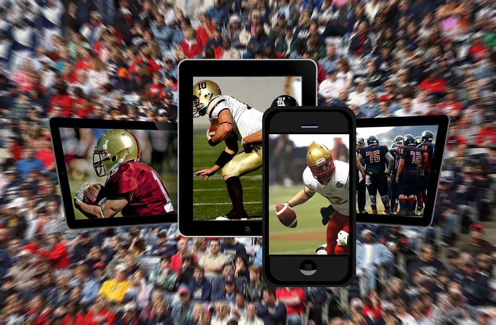 cell phones with photos of footballs players superimposed on a crowd of sports fans