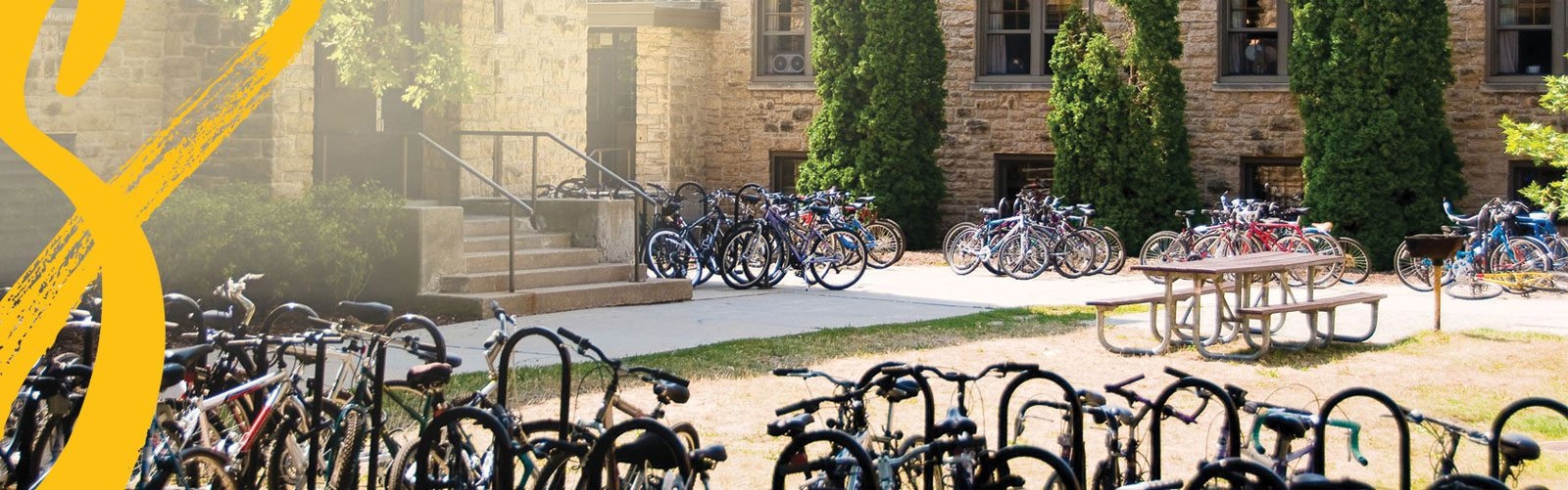 Full bikes racks outside of Kronshrage Hall