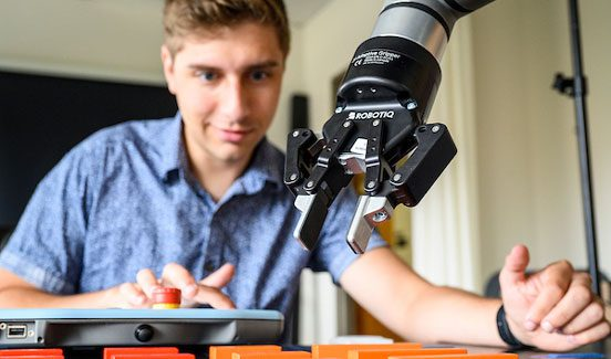 Student works on robotic arm