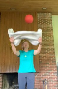 Cindy Kuhrasch tossing a ball up with a towel