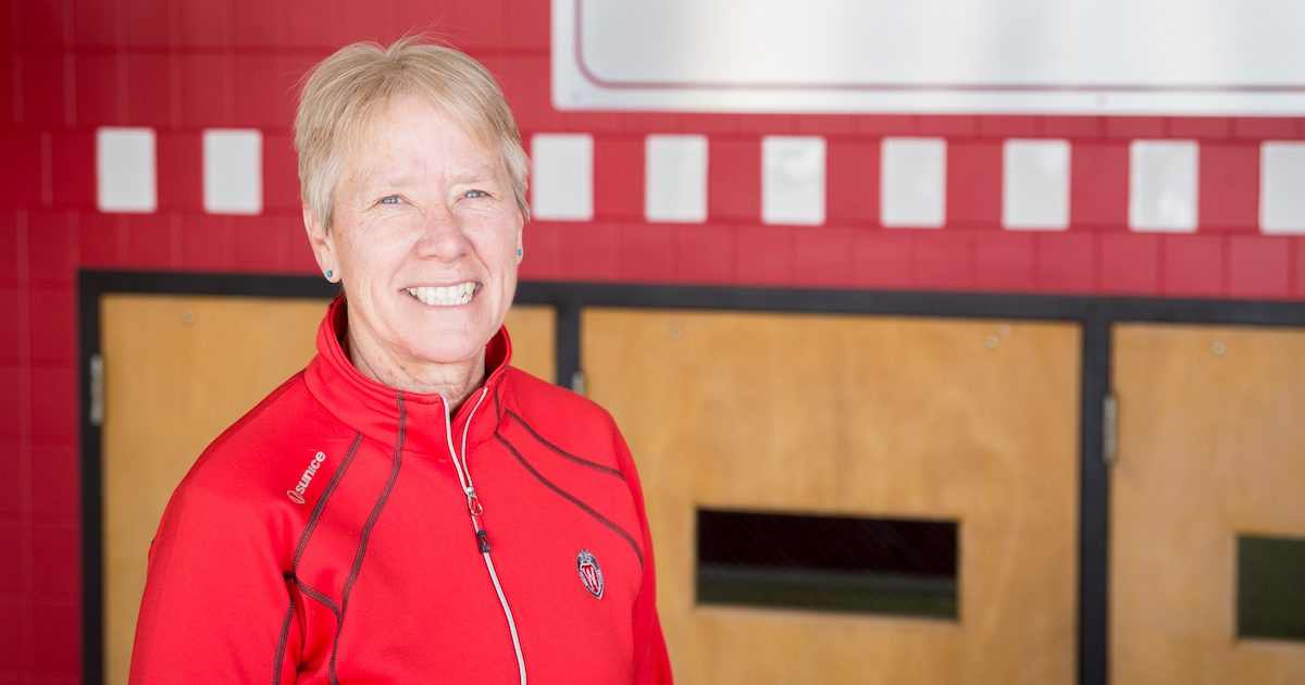 Cindy Kuhrasch with a Badger red jacket and a big smile