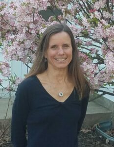 headshot of instructor Monica Theis in front of a blooming tree