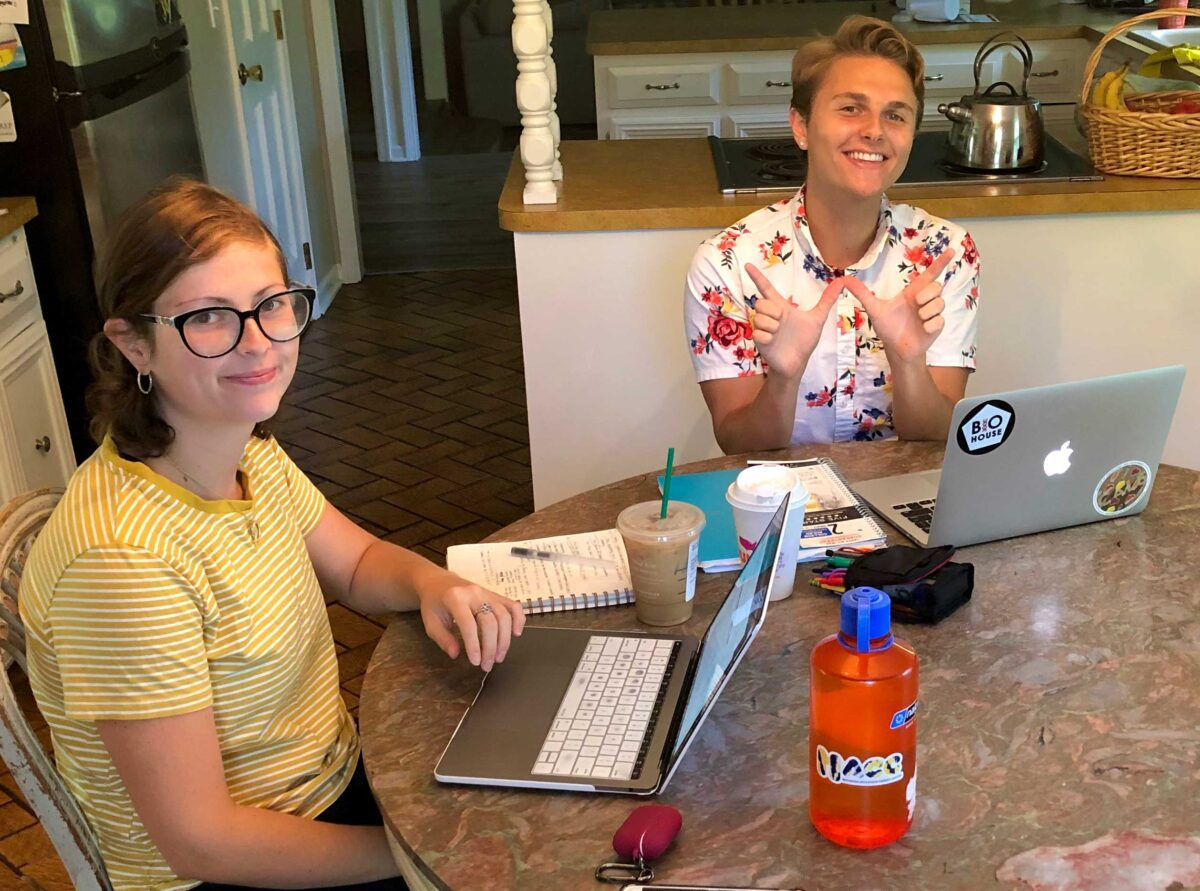 students studying with laptops at kitchen table