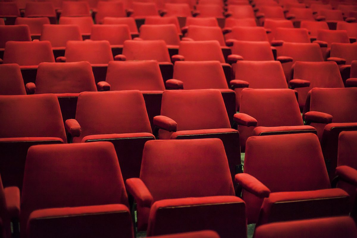 Empty red seats in a theater